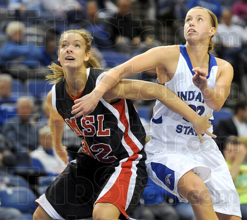 Position battle: Indiana State's #32, Andrea Rademacher fights for rebound position with St. Louis guard Kaitlin Sweatman during Sunday's game at Hulman Center.