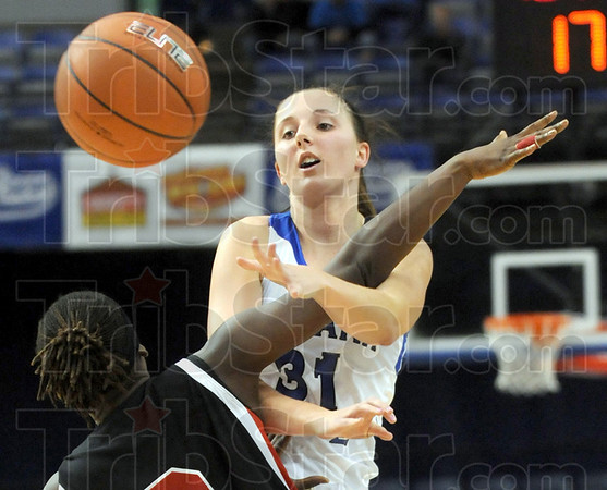 Whacked: Indiana State's #31, Kelsie Cooley is whacked across the arms after releasing a pass to an open teammate during game action Sunday afternoon at Hulman Center.