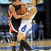 Ball battle: Indiana State's #13, Deja Mattox fights for a ball with a St. Louis player during game action Sunday.