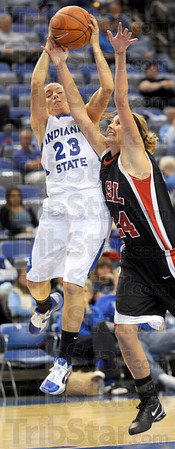 Fouled: Indiana State's #23, Taylor Whitley is fouled by Missouri-St. Louis player Caitlyn Moody during game action Sunday.