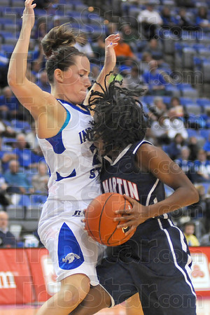 Solid effort: Taylor Whitley blocks the way to the basket for Skyhawk guard Jasmine Newsome.