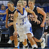 Run and gun: Sycamore guard Brittany Schoen heads up the floor with Skyhawks Jaclissa Haislip(20) andAubrey Reedy(45) in tow.