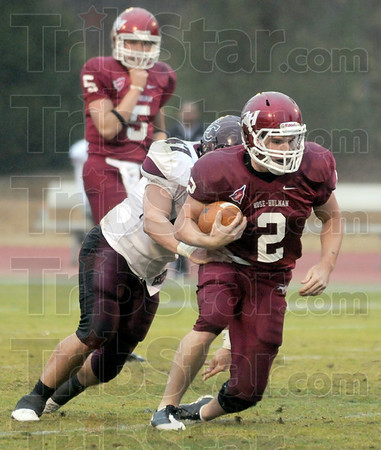 Workhorse: Rose-Hulman running-back Calvin Bueltel gains yardage during Saturday's game against Earlham College.