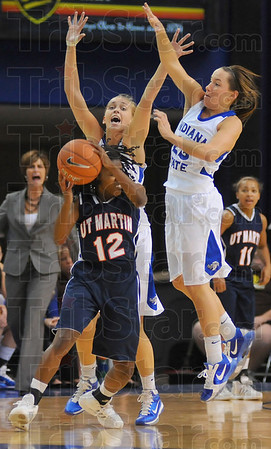 Harassment: UT Martin guard Jasmine Newsome(12) finds herself pressed by Sycamores Moriah Hodge and Taylor Whitley(23).