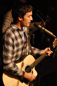 A newcomer to open mic, Jake Willis, sings summer songs to mourn the loss of summer.