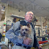 Center of attention: Joe Trotter, here with his yorkie Rex, runs Trotter Sport Center in Sullivan. A steady stream of customers walked into the store Friday evening, buying their licenses or and extra box of ammunition for today's opening day of deer gun season.