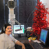 Christmas 24/7: All Christmas...all the time. Natalie Randall sits at the controls of one of the studio microphones Friday afternoon. The studio has been decorated with a tree and is pumping out Christmas music 24/7.