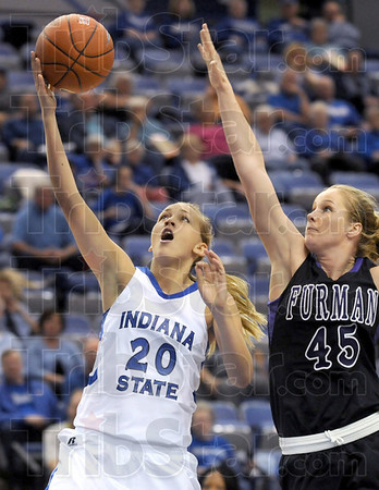 Runner: Indiana State's #20, Moriah Hodge drives the ball down the lane during game action against Furman's #45,