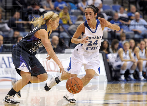 Ball pressure: Indiana State's #24, Illyssa Vivo pesters a Furman ballhandler as she brings the ball upcourt Friday night at Hulman Center.