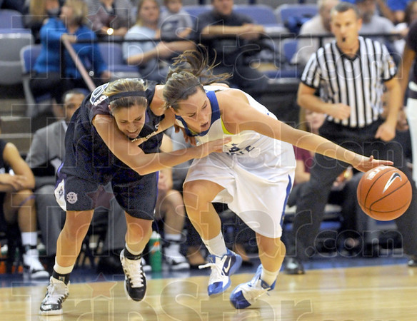 Scramble: Indiana State's #23, Taylor Whitley beats a furman player to a loose ball during Friday's game at Hulman Center.