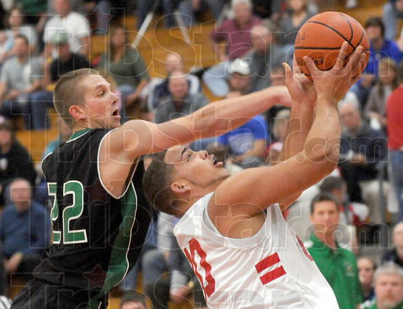 Fouled: West Vigo's #22, Scott West prevents South's #40, Jay Turner from scoring by whacking him across the arm during Jamboree action Friday night.