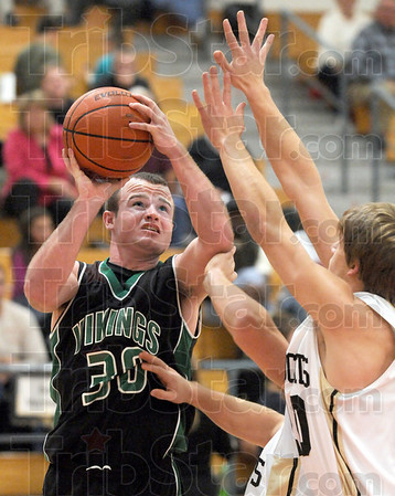 On the arm: West Vigo's #30, Cody Thornton gets hit on the arm as he takes the ball to the basket during Friday's Jamboree.