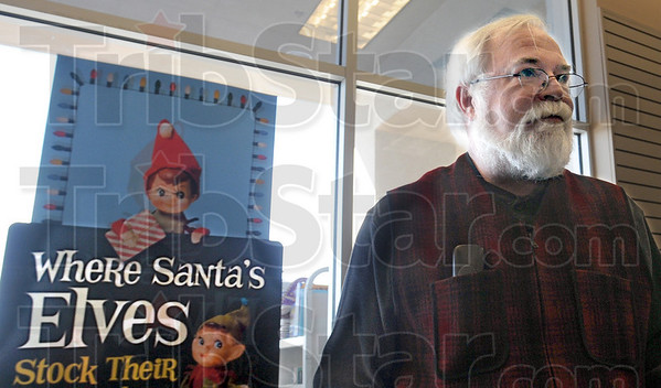 Santa's Elves: A man claiming to be Books-a-Million store manager Mark Gordon (R) looks suspiciously like one of Santa's Helpers as he goes about his duties at the store during Black Friday. Mark says business has seen about a fifteen percent increase over last year.