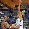 Fouled: Indiana State's #1, Brittany Schoen is fouled as she drives the ball to the basket during game action Friday night.
