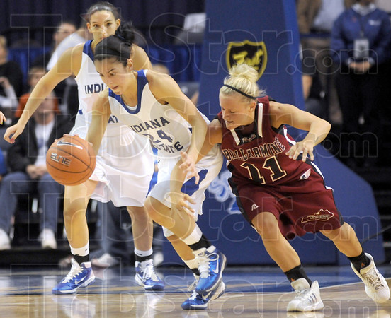 Theft in progress: Indiana State point guard #24, Illyssa Vivo steals the ball from Bellarmine's #11, Kylee Hamilton during first half action Friday night at Hulman Center.
