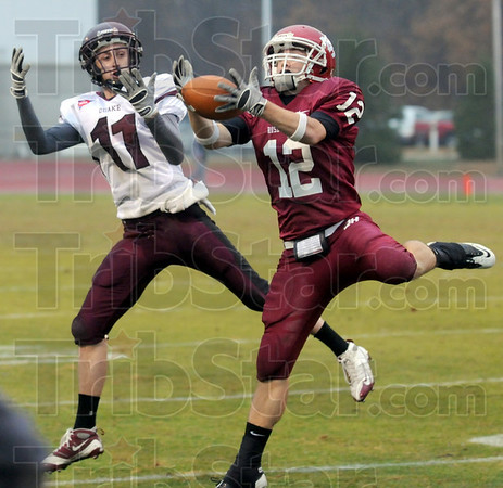 Picked: Rose-Hulman's #12, Jordan Martin intercepts a pass intended for Earlham's #11, Kyle Ripperger during second half play Saturday afternoon.