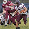 Pressure: Rose-Hulman's #91, Josh Yoder closes on Earlham ball carrier #6, Nick Cummings and stops him for a short gain.