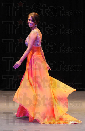 Filmy finery: Margaux Auxier wore a dayglow orange filmy gown for the evening gown portion of the Miss Banks of the Wabash Scholarship Program.