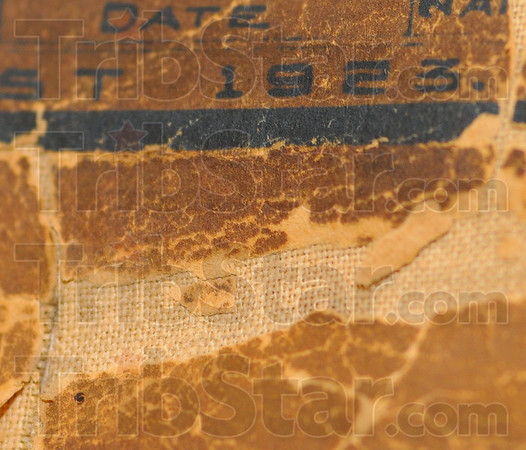Needs attention: Paper peels from its cloth backing near the date of this map of Terre Haute.