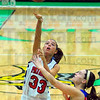 Looking for two: North Patriot Hannah Bledsoe(33) shoots from the paint past the defense of Owen Valley's Danielle Matsel in their 3rd place game.