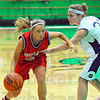 On the drive: Brave Haley Seibert moves around Greencastle defender Mallory Miller on her way to the hoop.
