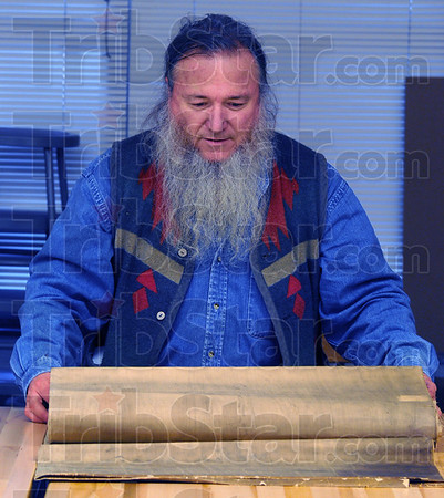 Safe keeping: Jim Canary packs away the 11 foot by about 6 foot cloth backed map of Terre Haute.
