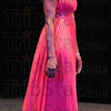 Pretty in pink: Ayanna Sykes models a pink evening gown in the Miss Crossroads to America Pagaent Saturday night.
