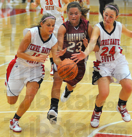 Ball hawks: Braves Haley Seibert(15) andKaylee Ellis(24) sandwich Northview's Lauren Webster(23) as she tries to bring the ball up the floor.