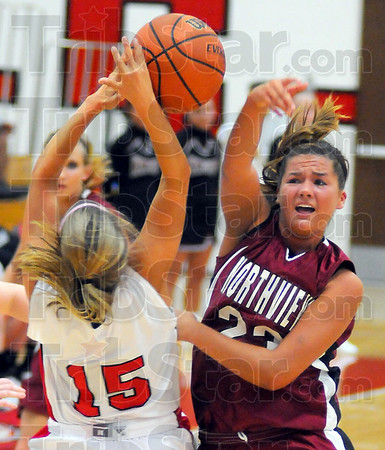 Learning curve: KnightLauren Webster has a pass blocked by Haley Seibert in first half action Saturday night on the Braves' floor.