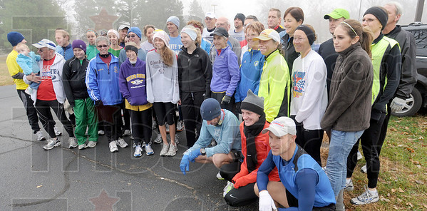 Community photo: Runners participating in the Community Run with Olympic marathon gold medalist Joan Benoit-Samuelson pose for a community photo prior to the start of the run Saturday morning.