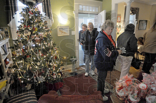 Welcoming: Participants in the annual Collett Park Christmas Walk enter a home on north 9th Street to the sight of a beautiful Christmas tree.