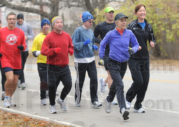 Community run: Joan Benoit-Samuelson (blue jacket) runs with a group of Terre Haute runners along the Heritage Trail Saturday morning. She was the 1984 Olympic Champion in the women's marathon.