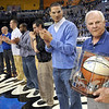 Thanks: Members of the 2000-2001 ISU basketball teams presented former coach Royce Waltman with an autographed basketball during Saturday's half-time ceremonies at Hulman Center.