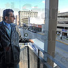 View: Mike Ellis stands on a third floor balcony overlooking downtown Terre Haute Saturday afternoon. He's the current owner of the Center City building.