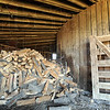 Storage space: In addition to some farm implements, firewood is stored in Kathryn and Courtney Crandells round barn.