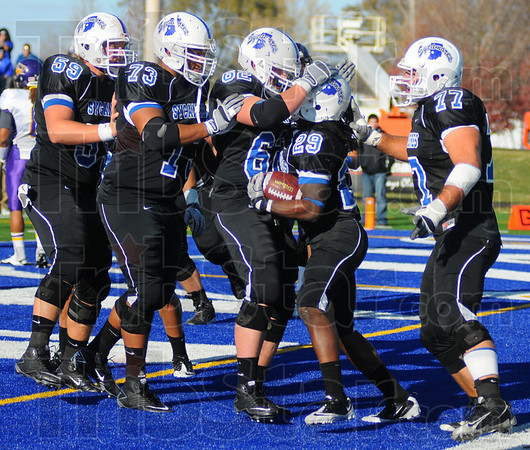 TEamwork: The ISU offensive line celebrates with running back Darrius Gates(29) after a touchdown. They are: Justin Wood(59),Mike Smith(73),Evan Borchers(62) and Ben Gefert(77).