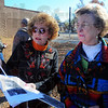 Gathering: Sandy Billing and Joyce Kemp look over photos and information regarding Benjamin Harrison School. The former Terre Haute School stood from 1892-1935. The Educational Heritage Association, Inc. of Vigo County  set signage up at the site at 7th and Lafayette.