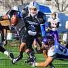 In trouble: Sycamore quarterback Ronnie Fouch tries to escape the tackle of Northern Iowa defender Will Eilert.