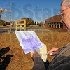 Here it was: Al Hamblen of the Educational Heritage Association Inc. of Vigo County looks at an old photo of the Benjamin Harrison School that stood along North Seventh Street near Lafayette Avenue. The organization placed signage at the site Saturday.