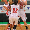 Relentless: Wildcat Kenzie Cheesewright finds herself all tied up by Terre Haute South defenders Dallas Butts(10),Claire Bailey(22) and Hannah Lee(35).
