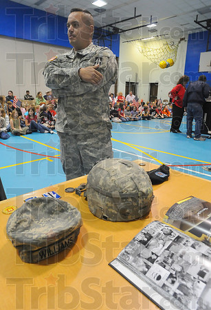 Tools of the trade: Army Sergeant Jesse Williams talks with Tribune-Star reporter Sue Laughlin prior to a school assembly at Ouabache Elementary School Wednesday morning.