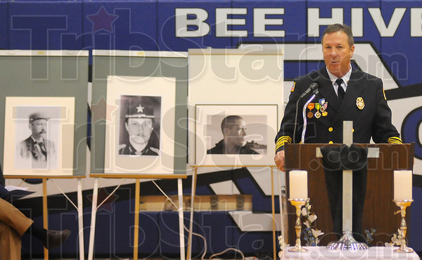 Heroes: Terre Haute Fire Department chief Jeff Fisher talks about three local men who died in the line of duty. Images of Firefighter John Osterloo, Vigo County Sheriff's deputy Kevin Artz and Army Sergeant Dale Griffin stand behind him.