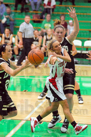 No look: Brave point guard Haley Seibert(15) dishes a pass to a teammate past the dfense of South Vermillion's Morgan Samuelson(20 and Adrienne Pritchard.