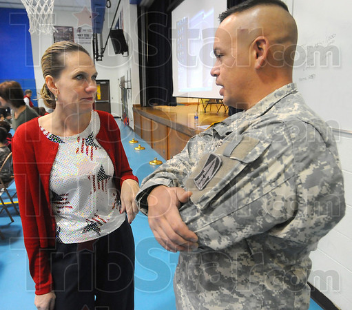 Vested interest: Michelle Kirby talks with Army Sergeant Jesse Williams before a Veteran's Day program at Ouabache Elementary Schol Wednesday morning. Kirby was his teacher while at Mclain School.