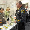Luncheon service: Vigo County superintendent Dan Tanoos and deputy superintendent Dr. Karen Goeller serve salads at the annual Principal for a Day event. Terre Haute Police Chief John Plasse who served as principal at Lost Creek Elementary school gets his lunch. Waiting in line is Bob Baesler and Mayor Duke Bennett who also took part in the event.