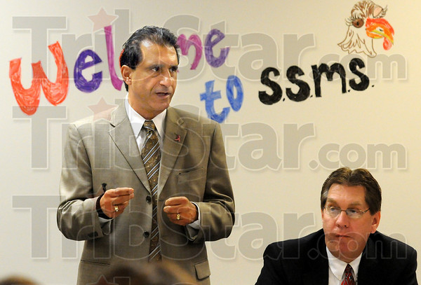 Welcome: Dan Tanoos welcomes the participants in the annual Principal for a Day event to a luncheon at Sarah Scott Middle School Wednesday afternoon. At right is Mayor Duke Bennett who was a participant in the event.