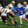 Surrounded: Quincy defenders Adam Dry(34) and others corral Indiana State reciever Justin Hilton.
