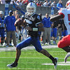 Waiting: Sycamore quarterback Ronnie Fouch rolls out as he waits for a reciever to get open.