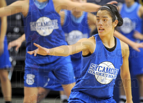 Drill baby drill: Indiana State University freshman Illysa Vivo participates in a defensive drill during Wednesday's practice at Hulman Center. She's expected to see playing-time at the point guard position.