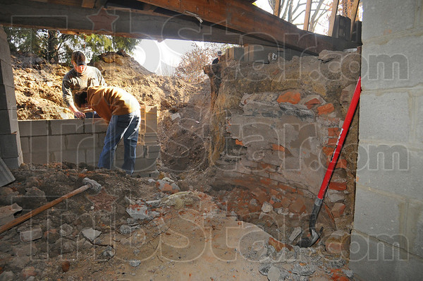 Back in time: Underneath the home under renovation is evidence of earlier times. In addition to a 4x16 cistern that needed to be filled in was a brick dome, the purpose of which has not yet been determined.